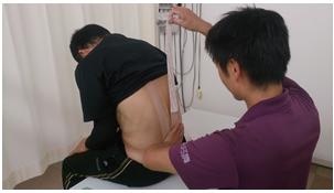 ぎっくり腰の治療法テーピング